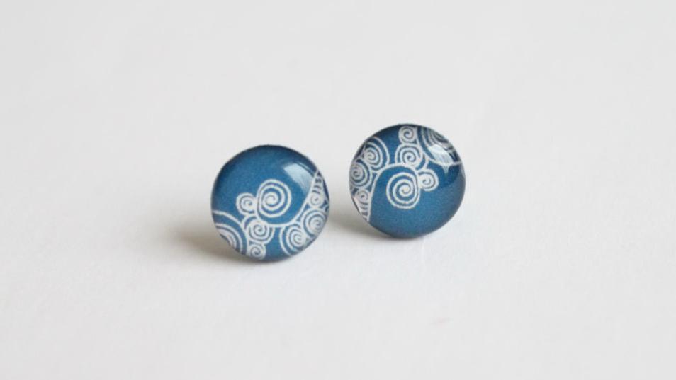 Steel blue swirly studs