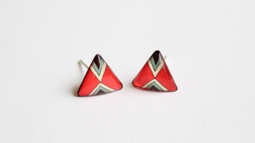 Bold and ethnic red triangle studs