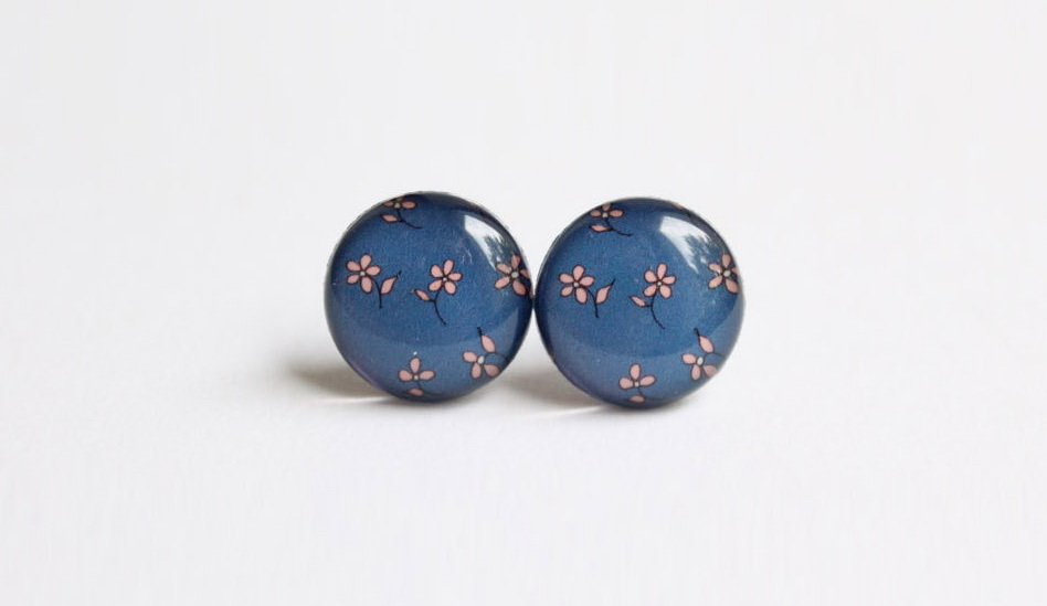 Stud earrings with nostalgic flowers on a dark blue background
